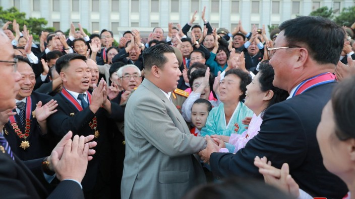 North Korean leader Kim Jong Un greets people during an event to mark the 73rd founding anniversary of North Korea in Pyongyang