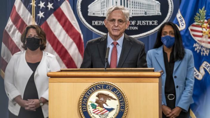 Attorney General Merrick B. Garland flanked by Deputy U.S. Attorney General Lisa Monaco, .and Associate U.S. Attorney G