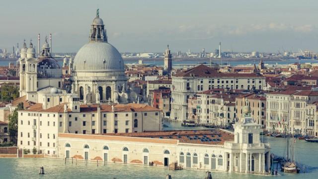 Punta della Dogana and Santa Maria della Salute standing at the meeting point of the Grand and Giudecca canals, Venice,