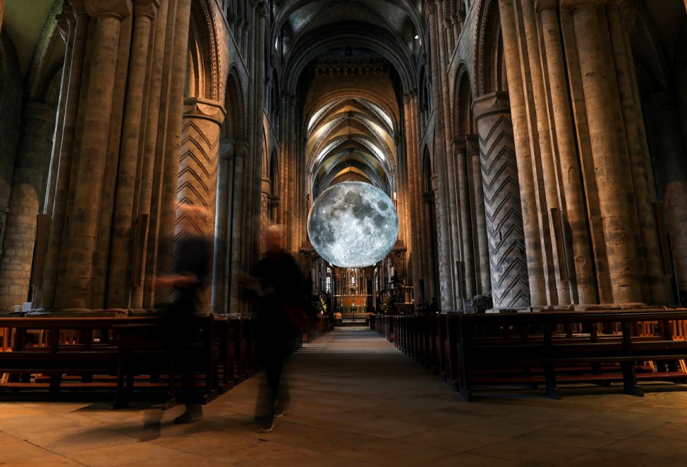 People visit Luke Jerram's 'Museum of the Moon' art installation inside Durham Cathedral