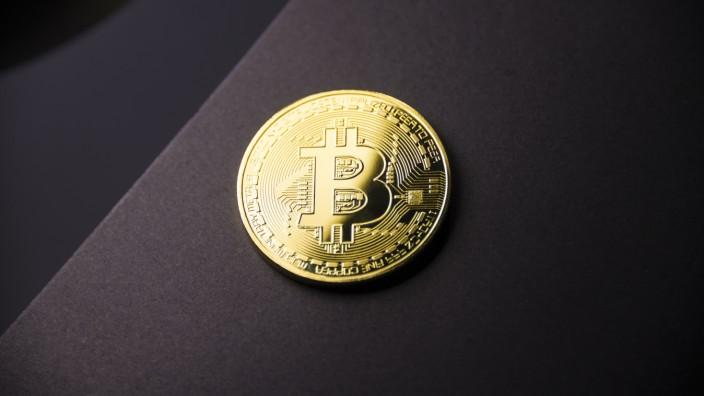 Ein Bitcoin als Goldmünze