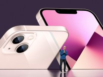 Apple CEO Tim Cook unveils the new iPhone 13 during a special event at Apple Park