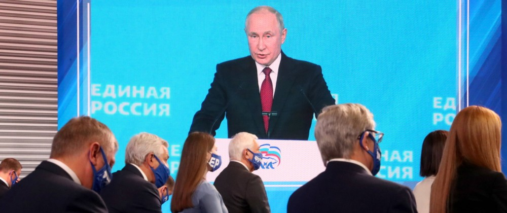 MOSCOW, RUSSIA   AUGUST 24, 2021: Russia s President Vladimir Putin (on the screen) makes remarks at the second stage of; putin