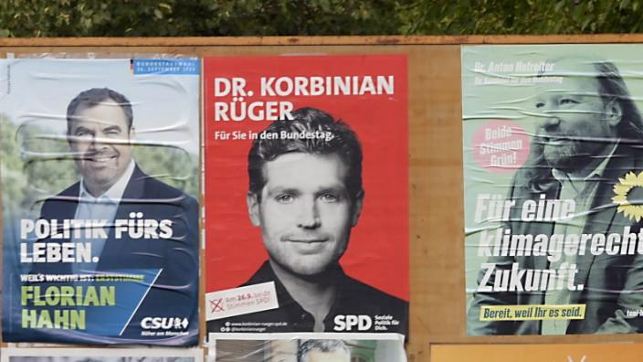 Bundestagswahl im Landkreis München: Nur einer kann es werden: Florian Hahn, Korbinian Rüger und Anton Hofreiter (von links) liegen in der Wählergunst ganz nah beieinander. Fotomontage: Claus Schunk