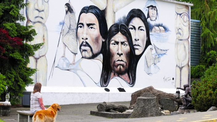 Cheryl Blackey model release and her dog Walker admire the mural Native Heritage by artist P; Kanada