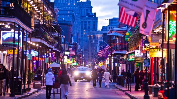 Bourbon Street lights up at dusk in New Orleans Louisiana New Orleans Louisiana USA PUBLICATIONxI