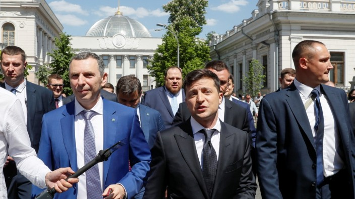 FILE PHOTO: Ukraine's President Volodymyr Zelenskiywalks from the parliament to the presidential administration office after his inauguration in Kiev