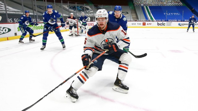 VANCOUVER, BC - MAY 03: Edmonton Oilers Right Wing Josh Archibald (15) goes for the puck while watched by Vancouver Canu; Josh Archibald