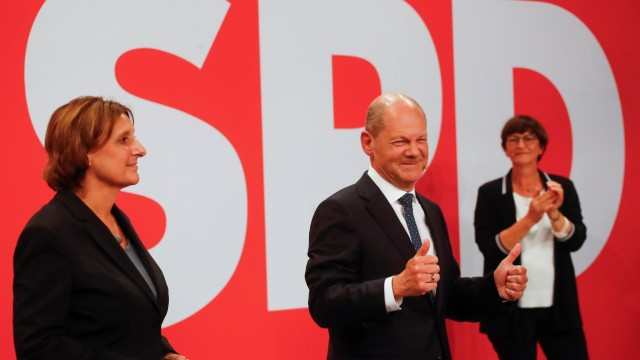 Reactions to the first exit polls from Social Democratic Party candidate Olaf Scholz and supporters at the party headquarters