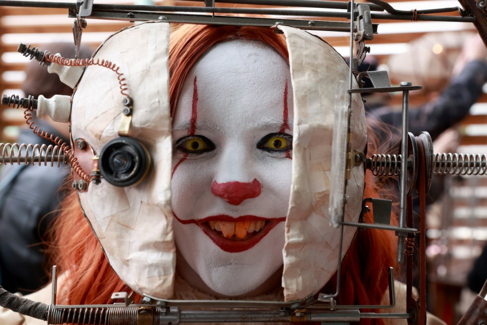 MOSCOW, RUSSIA - OCTOBER 2, 2021: A girl wears a clown makeup at the Geek Picnic festival of arts, science and technolo