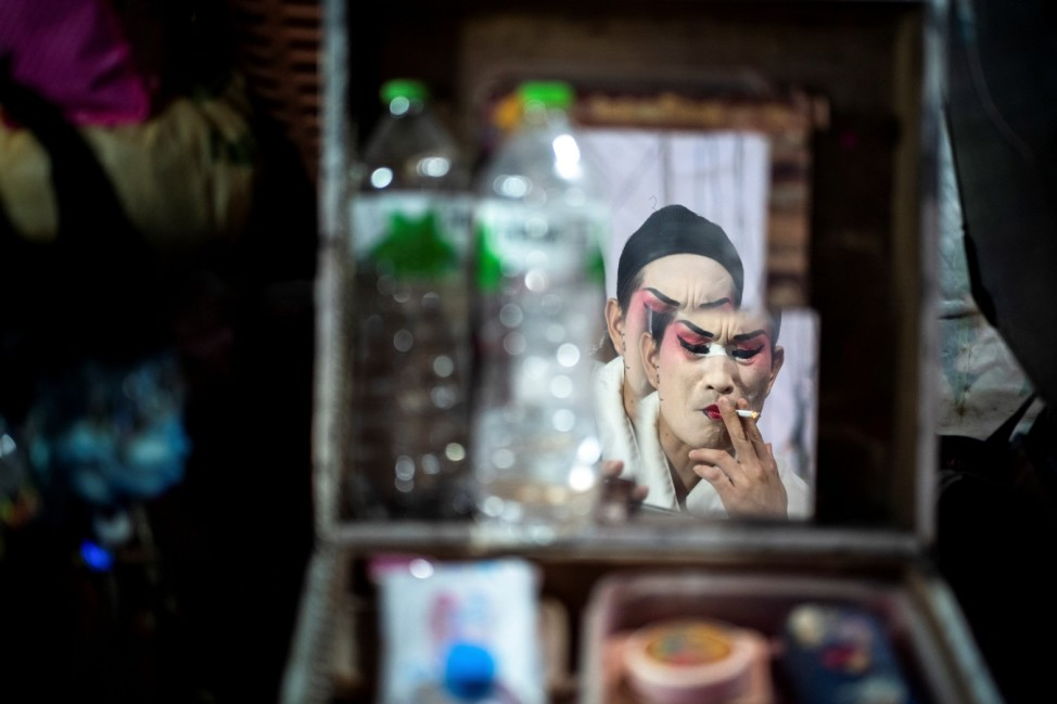Members of a Chinese opera troupe prepare backstage during the annual vegetarian festival in Bangkok