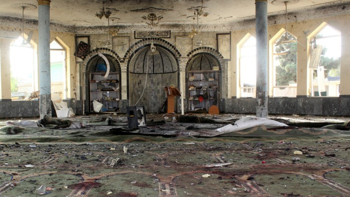 View of a mosque after a blast, in Kunduz