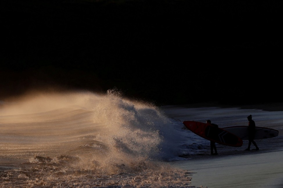 Surfers prepare to take to the sea