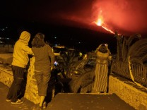People look at the volcano in eruption from Tajuya in La Palma, Canary Islands, Spain, early 05 October 2021. The main