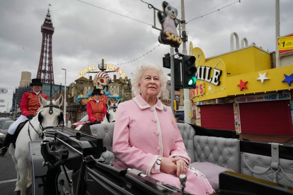 BESTPIX: New Queen Elizabeth Waxwork Paraded On Blackpool Promenade