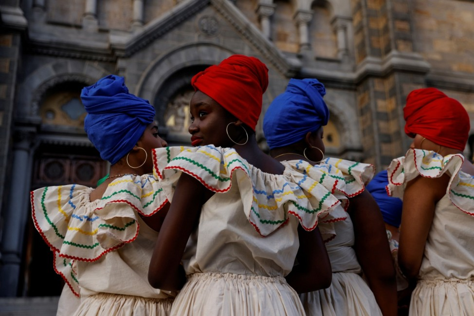 Members of a Haitian dance group wait to perform in the Mission Hill neighborhood of Boston