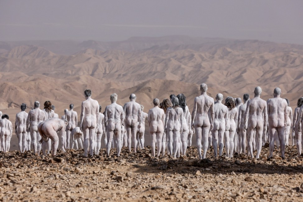 Hundreds undress to attend a Spencer Tunick photo shoot in Israel's desert