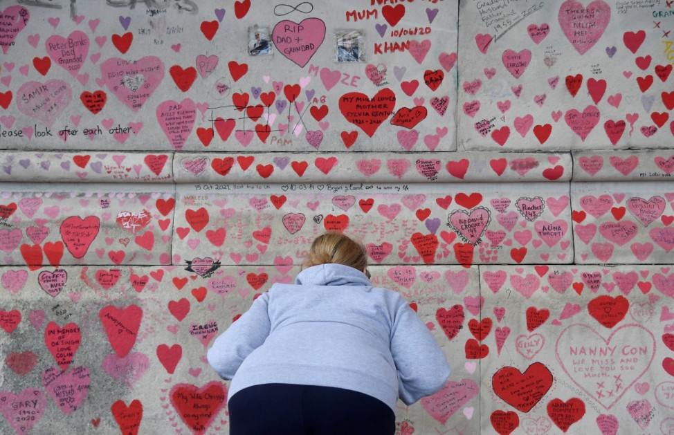 National Covid Memorial Wall, a dedication of thousands of hand painted hearts and messages commemorating victims of the COVID-19 pandemic, is seen in London