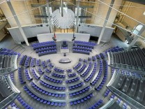 Empty seats are pictured before inaugural meeting of German lower house of Parliament after federal elections, in Berlin