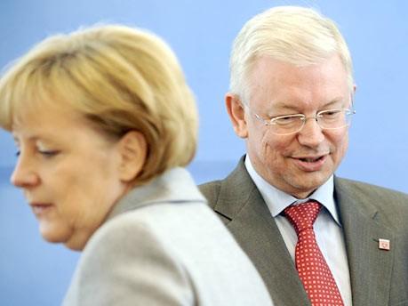 Roland Koch, Angela Merkel ddp