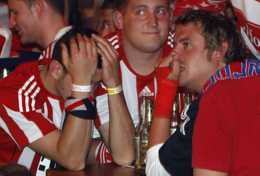 Bayern Munich soccer fans react after a goal by Inter Milan at a public viewing event in Munich
