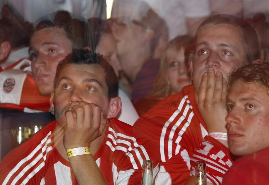 Bayern Munich soccer fans react at a public viewing event in Munich