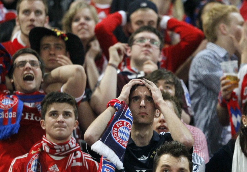 Supporters of Bayern Munich react during a public viewing at Munich's stadium