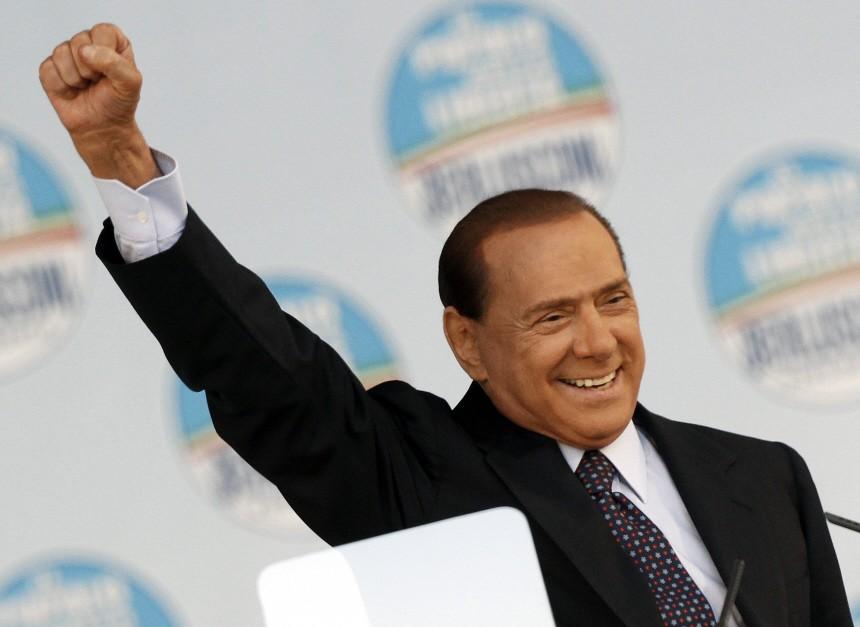 Italy's Prime Minister Silvio Berlusconi gestures as he speaks to supporters of the centre-right Popolo della Liberta in Rome