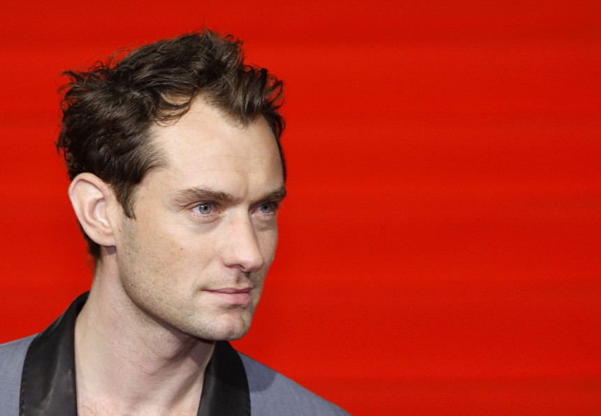 Actor Jude Law poses on the red carpet during the Japanese premiere for the film 'Sherlock Holmes', in Tokyo