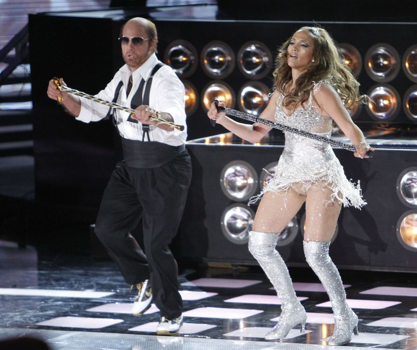 Jennifer Lopez and actor Tom Cruise as Les Grossman perform at the 2010 MTV Movie Awards in Los Angeles