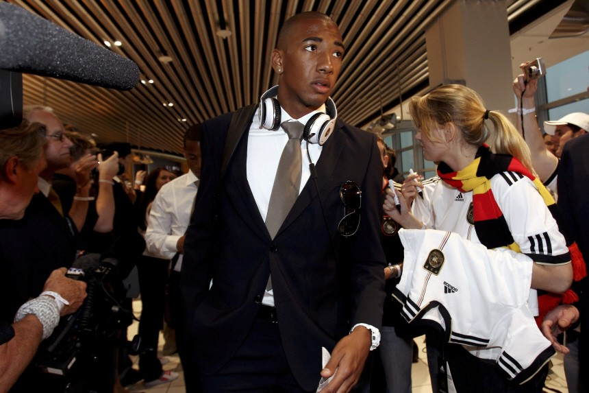Boateng is surrounded by fellow passengers on his way to boarding during a fan event before the departure of the German national football team to the FIFA 2010 World Cup in South Africa at the Frankfurt airport