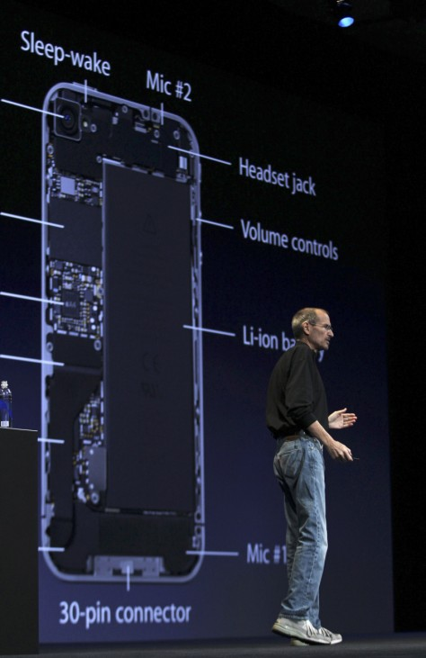 Apple CEO Steve Jobs stands in front of a graphic of the interior of the new iPhone 4 at the Apple Worldwide Developers Conference in San Francisco
