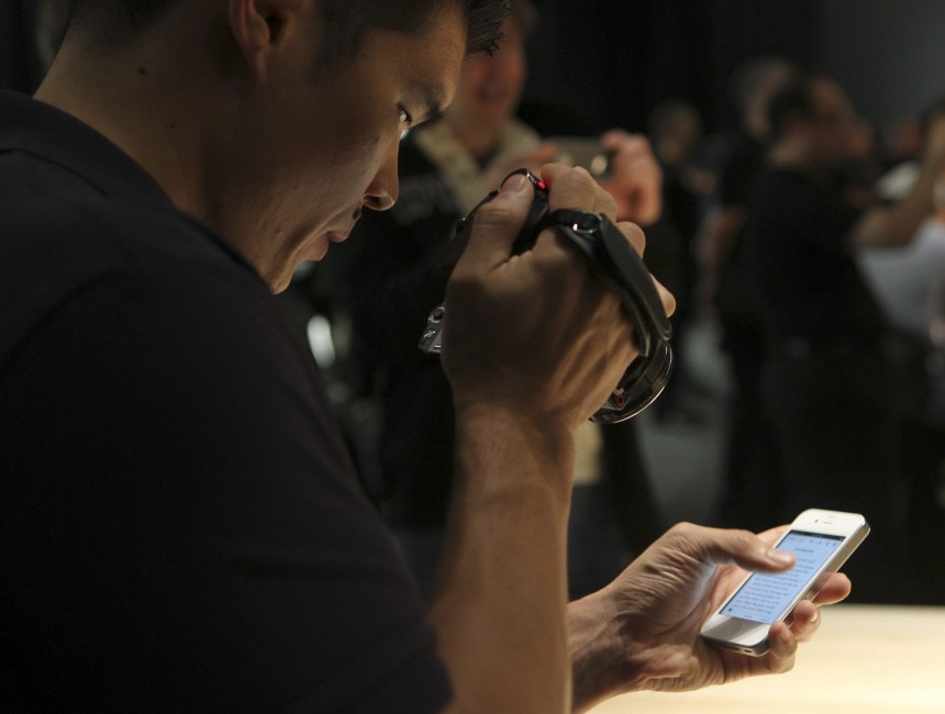 A member of the media takes a video of the new iPhone 4 following the device's unveiling by Apple CEO Steve Jobs in San Francisco, California