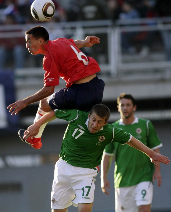 Cereceda of Chile fights for the ball with Lawrie of Northern Ireland during an international friendly soccer match at Chillan city