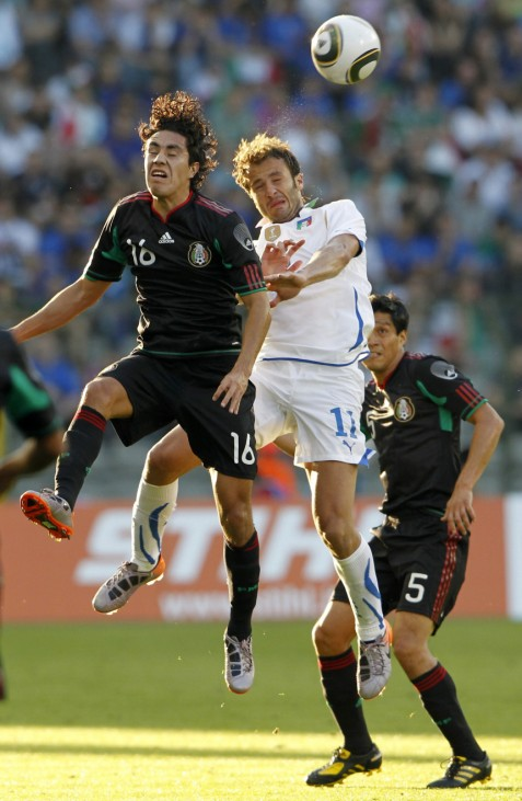 Mexico's Juarez jumps for the ball with Italy's Gilardino during an international friendly soccer match in Brussels