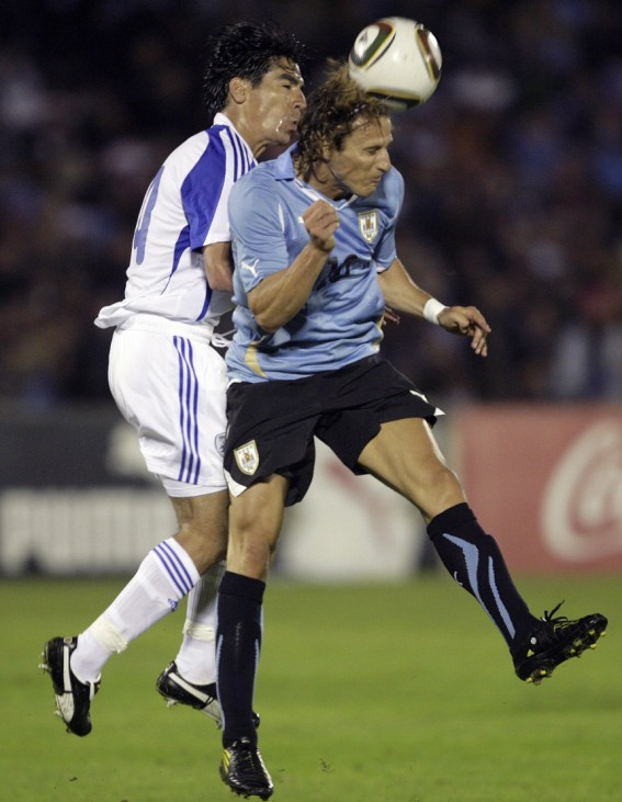 Uruguay's Diego Forlan heads the ball under pressure from David Ziv Yoav of Israel during their friendly soccer match in Montevideo