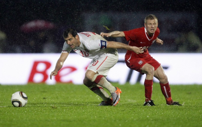 Serbia's Stankovic fights for the ball with Poland's Nowak during a friendly soccer match in Kufstein