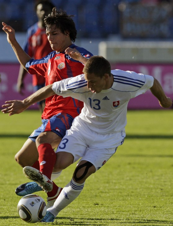 Slovakia's Holosko fights for the ball with Costa Rica's Guzman during their friendly soccer match in Bratislava