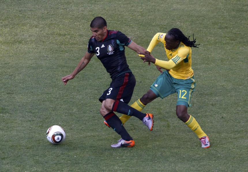 South Africa's Letsholonyane battles for the ball with Mexico's Salcido during the 2010 World Cup opening match at Soccer City stadium in Johannesburg
