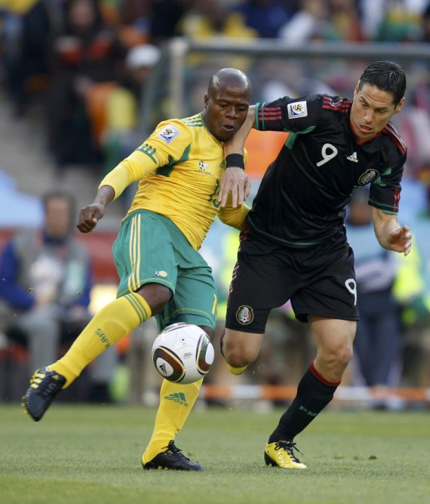 South Africa's Lucas Thwala (L) fights for the ball with Mexico's Guillermo Franco during the 2010 World Cup opening match at Soccer City stadium in Johannesburg