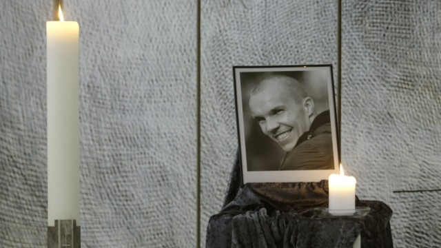 A photo of Hannover 96's Enke is seen in the chapel of the Schalke 04 stadium in Gelsenkirchen
