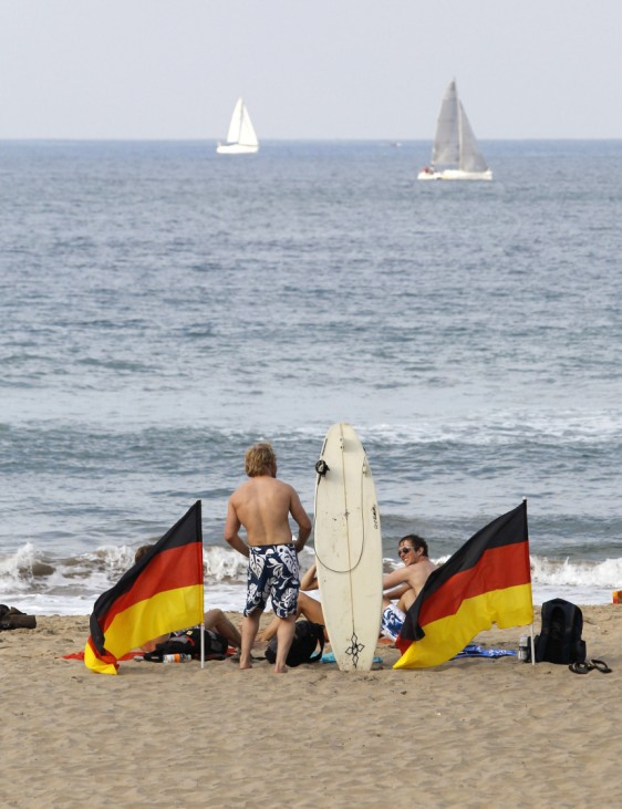 German soccer fans relax at Durban's beach front