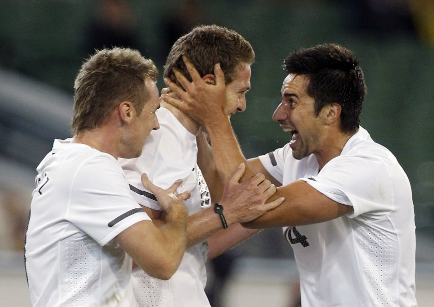 Smeltz and Fallon congratulate Killen who scored against Australia during their international friendly soccer match in Melbourne