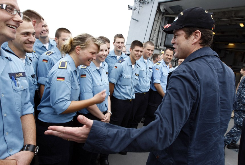 Guttenberg talks to German Navy sailors during visit to German Navy frigate Hessen at an undisclosed position in the Mediterranean Sea