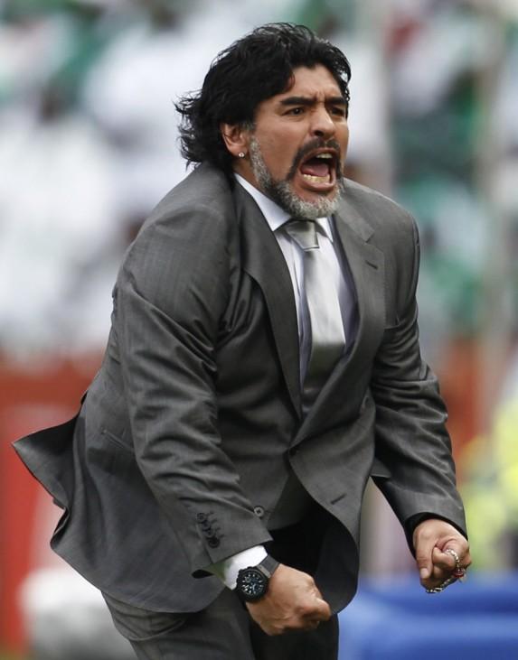 Argentina's coach Maradona celebrates his team's goal against Nigeria during the 2010 World Cup Group B soccer match at Ellis Park stadium in Johannesburg