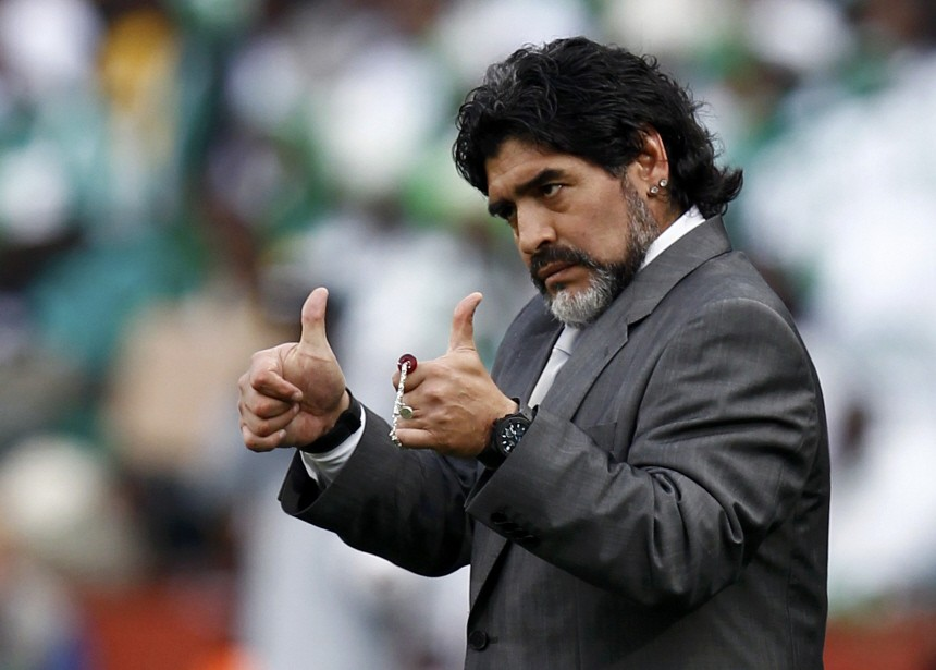 Argentina's coach Maradona gives thumbs-up during a 2010 World Cup Group B soccer match against Nigeria at Ellis Park stadium in Johannesburg