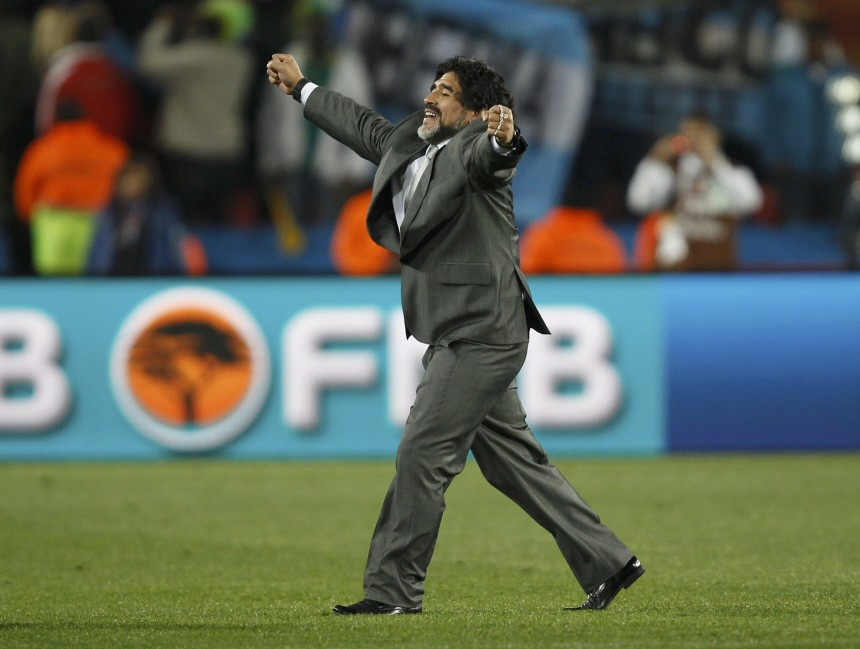 Argentina's coach Maradona celebrates his team's win over Nigeria after the 2010 World Cup Group B soccer match at Ellis Park stadium in Johannesburg