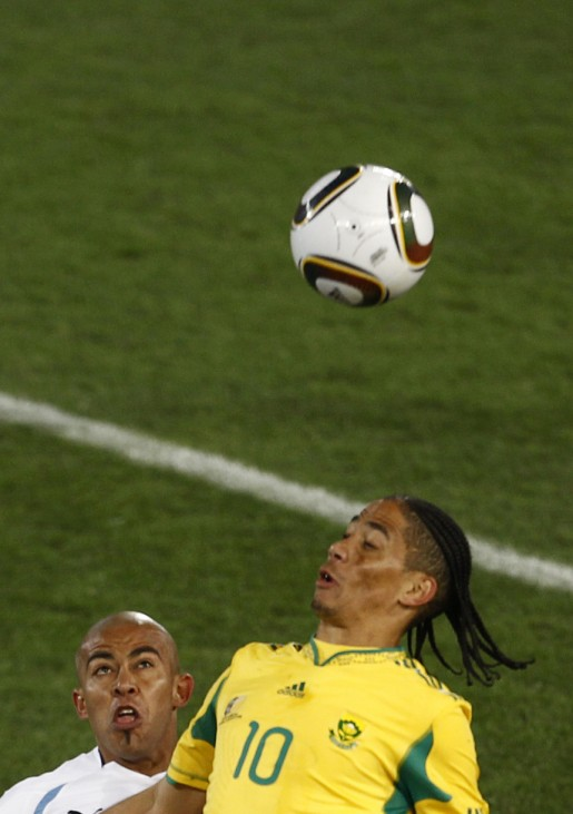South Africa's Pienaar fights for the ball against Uruguay's Arevalo during the 2010 World Cup Group A soccer match at Loftus Versfeld stadium in Pretoria