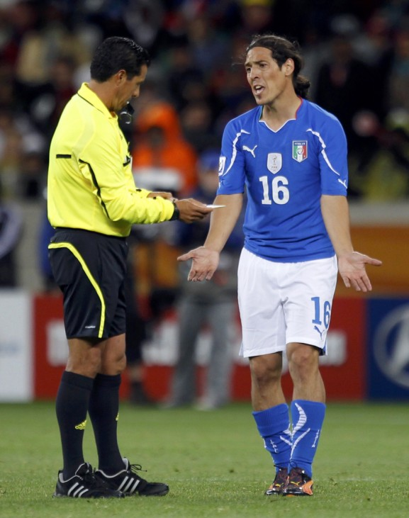 Italy's Mauro Camoranesi appeals to referee Benito Archundia of Mexico after receiving a yellow card during their 2010 World Cup Group F soccer match against Paraguay at Green Point stadium in Cape Town