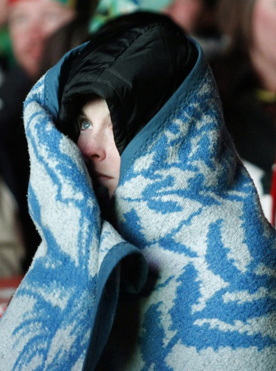A woman in a fan zone watches the 2010 World Cup match between South Africa and Uruguay in Johannesburg